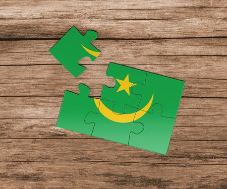 Mauritania national flag on jigsaw puzzle. One piece is missing. Danger concept. 版權商用圖片