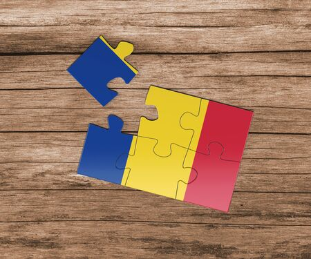 Romania national flag on jigsaw puzzle. One piece is missing. Danger concept. 版權商用圖片