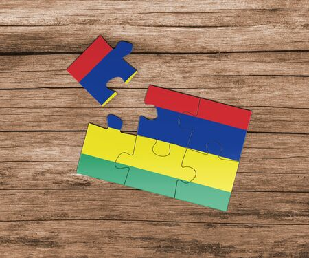 Mauritius national flag on jigsaw puzzle. One piece is missing. Danger concept. 版權商用圖片