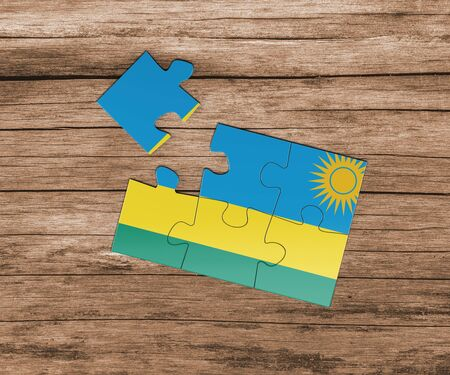 Rwanda national flag on jigsaw puzzle. One piece is missing. Danger concept.
