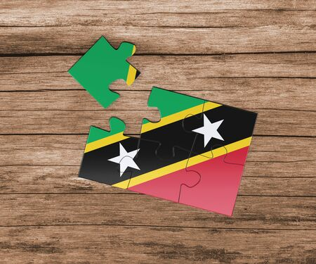 Saint Kitts And Nevis national flag on jigsaw puzzle. One piece is missing. Danger concept. 版權商用圖片