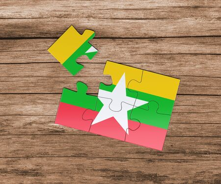 Myanmar national flag on jigsaw puzzle. One piece is missing. Danger concept.