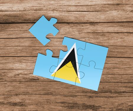 Saint Lucia national flag on jigsaw puzzle. One piece is missing. Danger concept.