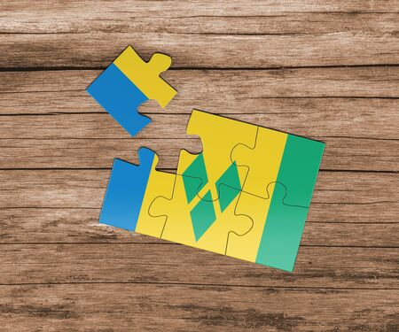 Saint Vincent And The Grenadines national flag on jigsaw puzzle. One piece is missing. Danger concept.