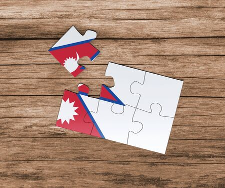 Nepal national flag on jigsaw puzzle. One piece is missing. Danger concept. 版權商用圖片