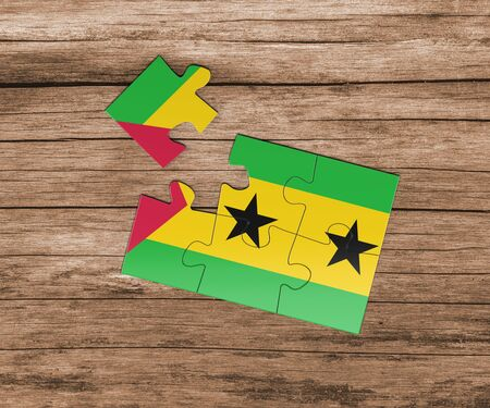 Sao Tome And Principe national flag on jigsaw puzzle. One piece is missing. Danger concept.