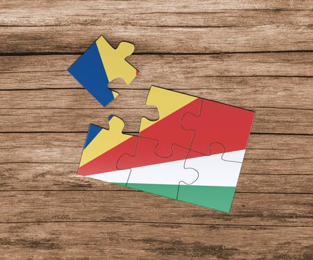 Seychelles national flag on jigsaw puzzle. One piece is missing. Danger concept. Banque d'images