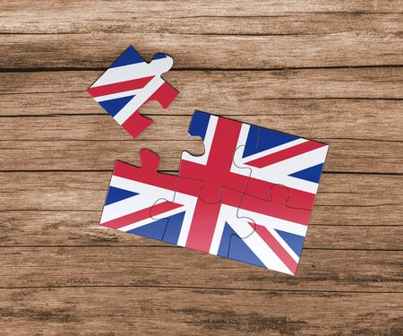 United Kingdom national flag on jigsaw puzzle. One piece is missing. Danger concept. Banque d'images