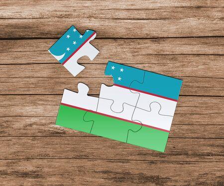 Uzbekistan national flag on jigsaw puzzle. One piece is missing. Danger concept. Banque d'images