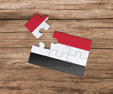 Yemen national flag on jigsaw puzzle. One piece is missing. Danger concept.