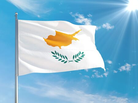 Cyprus national flag waving in the wind against deep blue sky. High quality fabric. International relations concept. Stock fotó