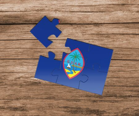 Guam national flag on jigsaw puzzle. One piece is missing. Danger concept.