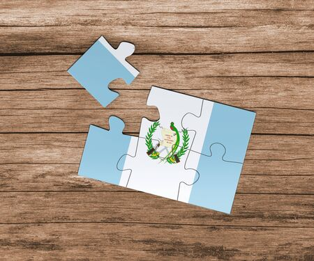 Guatemala national flag on jigsaw puzzle. One piece is missing. Danger concept. 版權商用圖片
