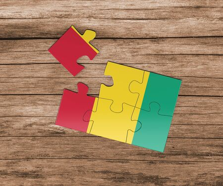 Guinea Bissau national flag on jigsaw puzzle. One piece is missing. Danger concept.