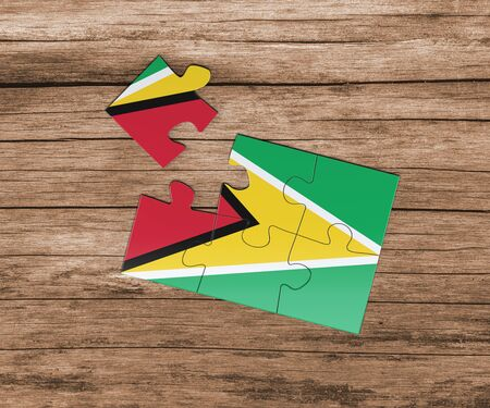 Guyana national flag on jigsaw puzzle. One piece is missing. Danger concept.