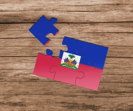 Haiti national flag on jigsaw puzzle. One piece is missing. Danger concept. 版權商用圖片