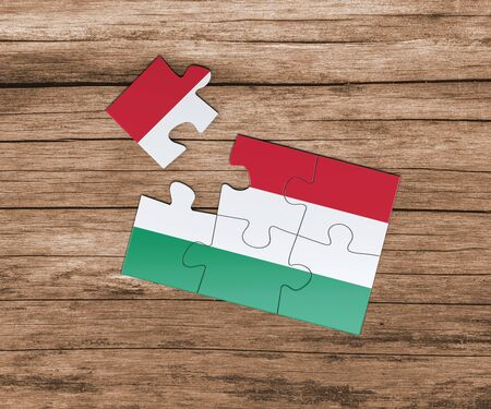 Hungary national flag on jigsaw puzzle. One piece is missing. Danger concept.