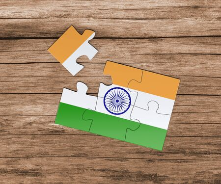 India national flag on jigsaw puzzle. One piece is missing. Danger concept.