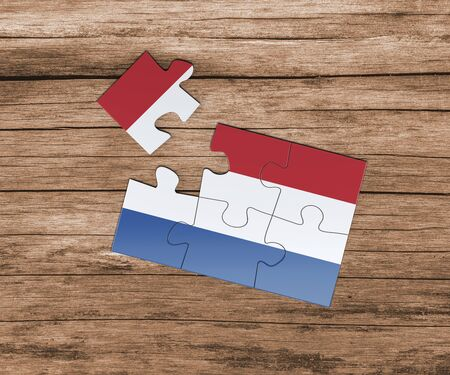 Netherlands national flag on jigsaw puzzle. One piece is missing. Danger concept.