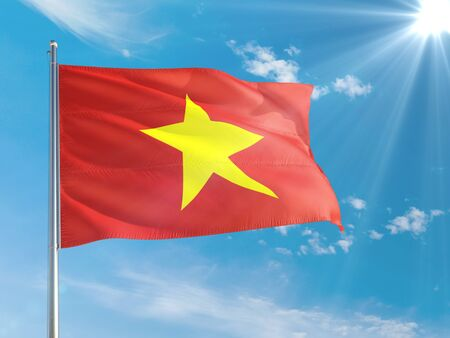 Vietnam national flag waving in the wind against deep blue sky. High quality fabric. International relations concept.