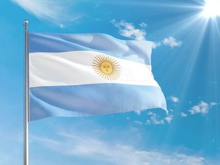 Argentina national flag waving in the wind against deep blue sky. High quality fabric. International relations concept. Standard-Bild