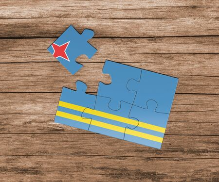 Aruba national flag on jigsaw puzzle. One piece is missing. Danger concept.
