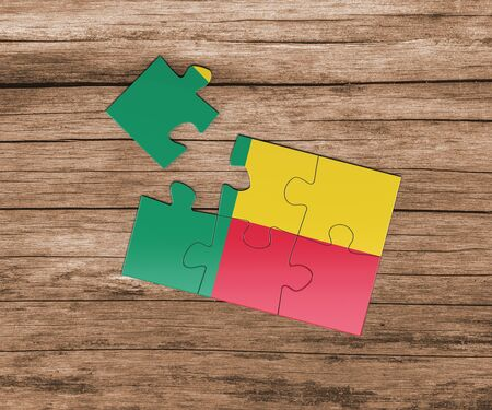 Benin national flag on jigsaw puzzle. One piece is missing. Danger concept.