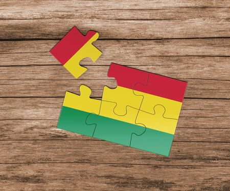 Bolivia national flag on jigsaw puzzle. One piece is missing. Danger concept.