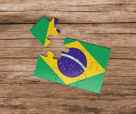 Brazil national flag on jigsaw puzzle. One piece is missing. Danger concept. Stock Photo