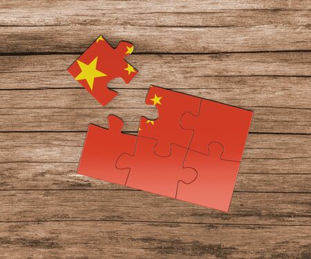 China national flag on jigsaw puzzle. One piece is missing. Danger concept.