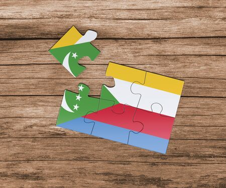 Comoros national flag on jigsaw puzzle. One piece is missing. Danger concept. Banque d'images