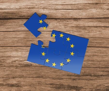 European Union national flag on jigsaw puzzle. One piece is missing. Danger concept.