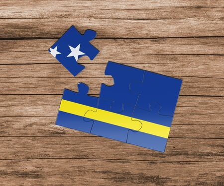 Curacao national flag on jigsaw puzzle. One piece is missing. Danger concept.