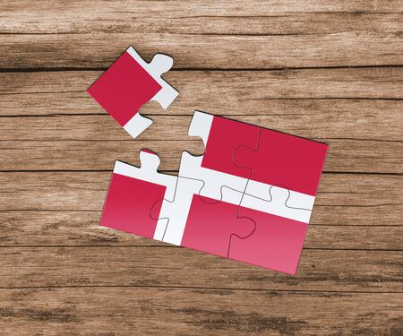 Denmark national flag on jigsaw puzzle. One piece is missing. Danger concept.