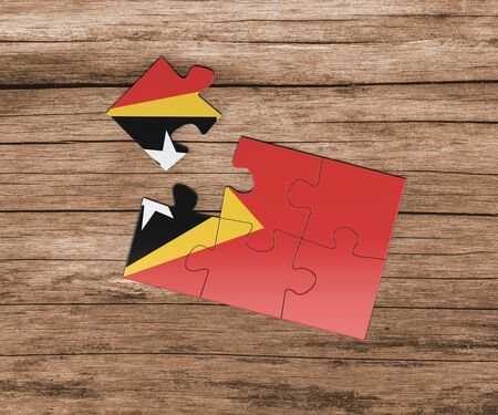 East Timor national flag on jigsaw puzzle. One piece is missing. Danger concept.
