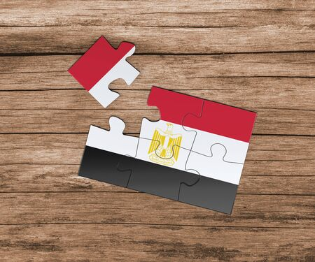 Egypt national flag on jigsaw puzzle. One piece is missing. Danger concept. 版權商用圖片