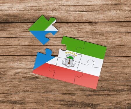 Equatorial Guinea national flag on jigsaw puzzle. One piece is missing. Danger concept. 版權商用圖片