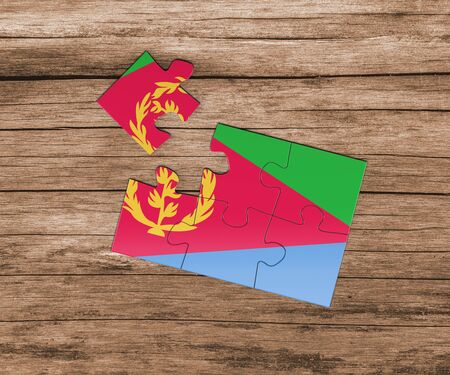 Eritrea national flag on jigsaw puzzle. One piece is missing. Danger concept.