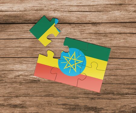 Ethiopia national flag on jigsaw puzzle. One piece is missing. Danger concept. 版權商用圖片