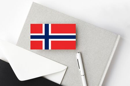 Norway flag on minimalist letter background. National invitation envelope with white pen and notebook. Communication concept. Standard-Bild