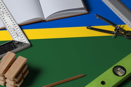 Solomon Islands national flag on profession concept with architect desk and tools background. Top view mock-up.