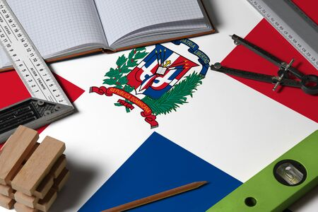 Dominican Republic national flag on profession concept with architect desk and tools background. Top view mock-up.