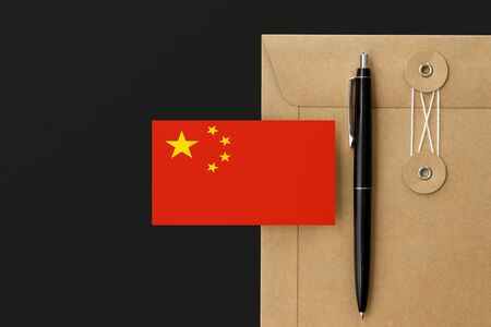China flag on craft envelope letter and black pen background. National invitation concept. Invitation for education theme.