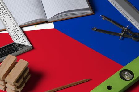 Philippines national flag on profession concept with architect desk and tools background. Top view mock-up.