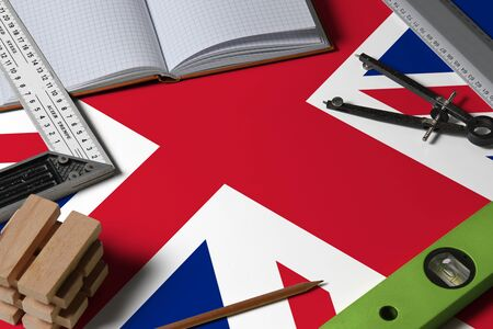 United Kingdom national flag on profession concept with architect desk and tools background. Top view mock-up.