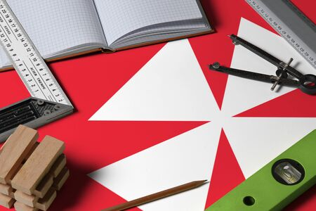 Wallis And Futuna national flag on profession concept with architect desk and tools background. Top view mock-up.