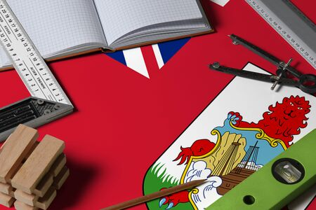 Bermuda national flag on profession concept with architect desk and tools background. Top view mock-up.
