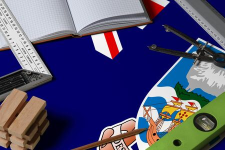 Falkland Islands national flag on profession concept with architect desk and tools background. Top view mock-up. Stockfoto