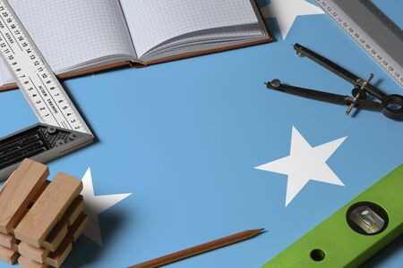 Micronesia national flag on profession concept with architect desk and tools background. Top view mock-up.