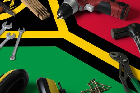 Vanuatu flag on repair tool concept wooden table background. Mechanical service theme with national objects. Stock fotó